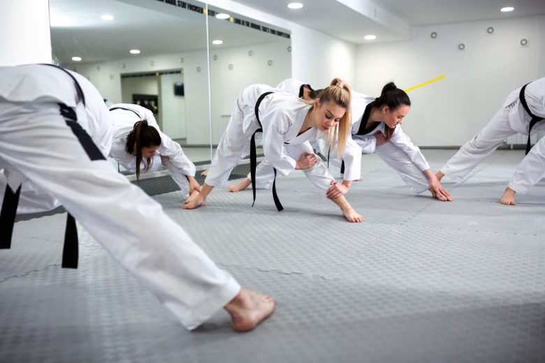 Young women stretching in martial arts