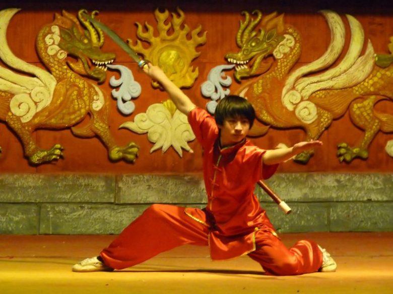 Young man displaying dragon animal kung fu