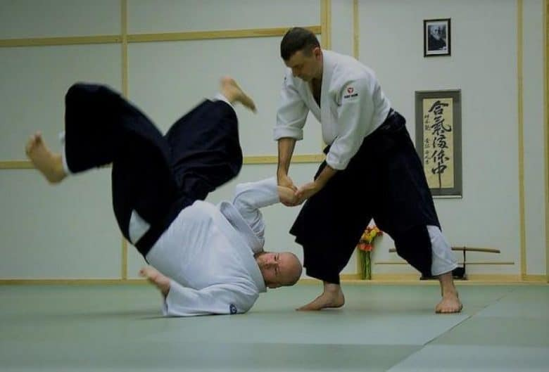 One man throwing another man to the ground in Aikido