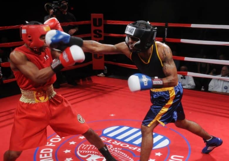 Two boxers with headgear one striking the other