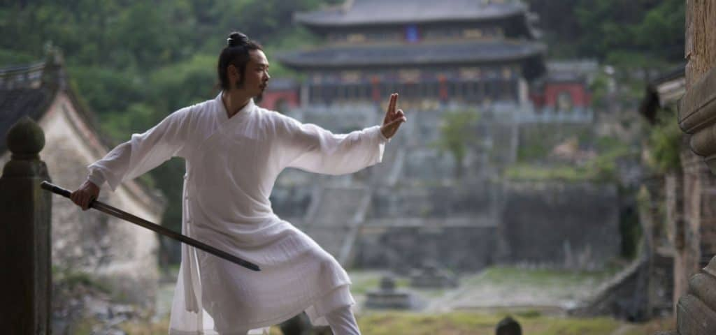 Man practicing Wudang in front of temple