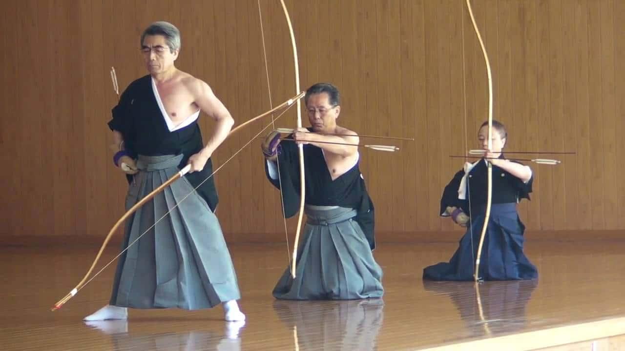 3 people practicing Kyudo