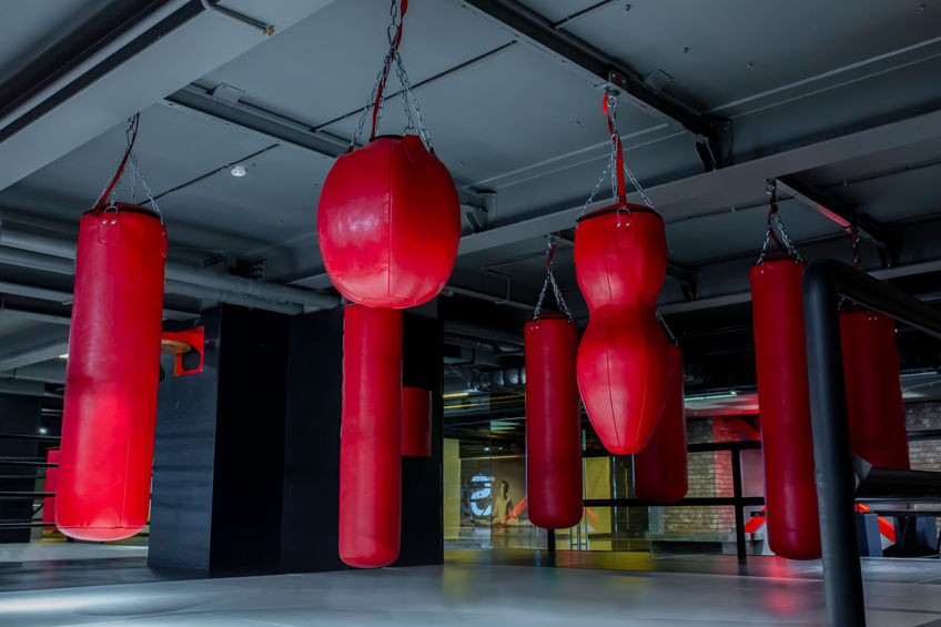 Different red punch bags hanging from ceiling